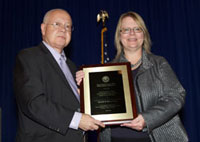 Dr. Petzel presents the 2012 USH award to Elizabeth Martin Yano, Ph.D.
