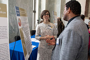 Lucy Leykum,MD, MBA, MSc (L) talks with a visitor to VA Research Day on the Hill.