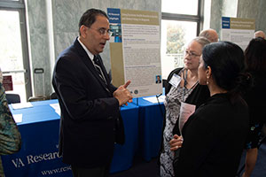 Hardeep Singh, MD, MPH, (L) discussing his work on patient safety at VA Research Day on the Hill.