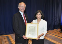 Madhu Agarwal, M.D., M.P.H., Deputy Under Secretary for Health for Policy and Services and Seth Eisen, M.D., M.Sc., Director of HSR&D, recipient of the Under Secretary for Health's Exemplary Service Award