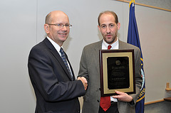 Dr. David Atkins congratulating Dr. Hayden Bosworth on being awarded the 2013 VA Under Secretary's Award for Outstanding Achievement in Health Services Research.