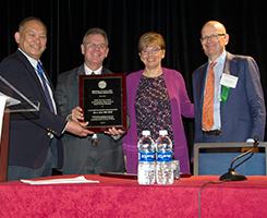 Dr. Eve Kerr, second from right is presented the USH 2017 award