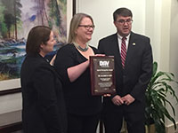 Elizabeth Yano, PhD, MSPH (center) received the Disabled American Veterans'  (DAV) Special Recognition Award